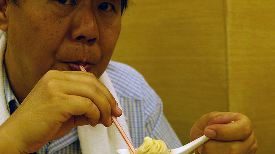 Looks like a good way to eat a soup dumpling, but it's only a straw man. (Flickr)