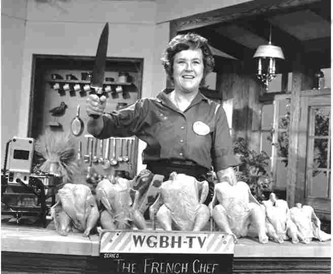 "Julia Child poses with ""the chicken sisters"" before an episode of The French Chef in which she teaches us how to roast a bird."