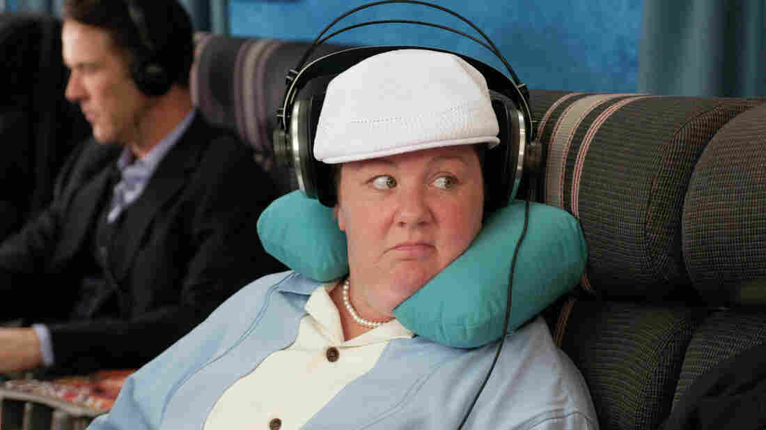 As Melissa McCarthy's etiquette-minded character in Bridesmaids demonstrates, there's nothing wrong with wearing headphones on an airplane.