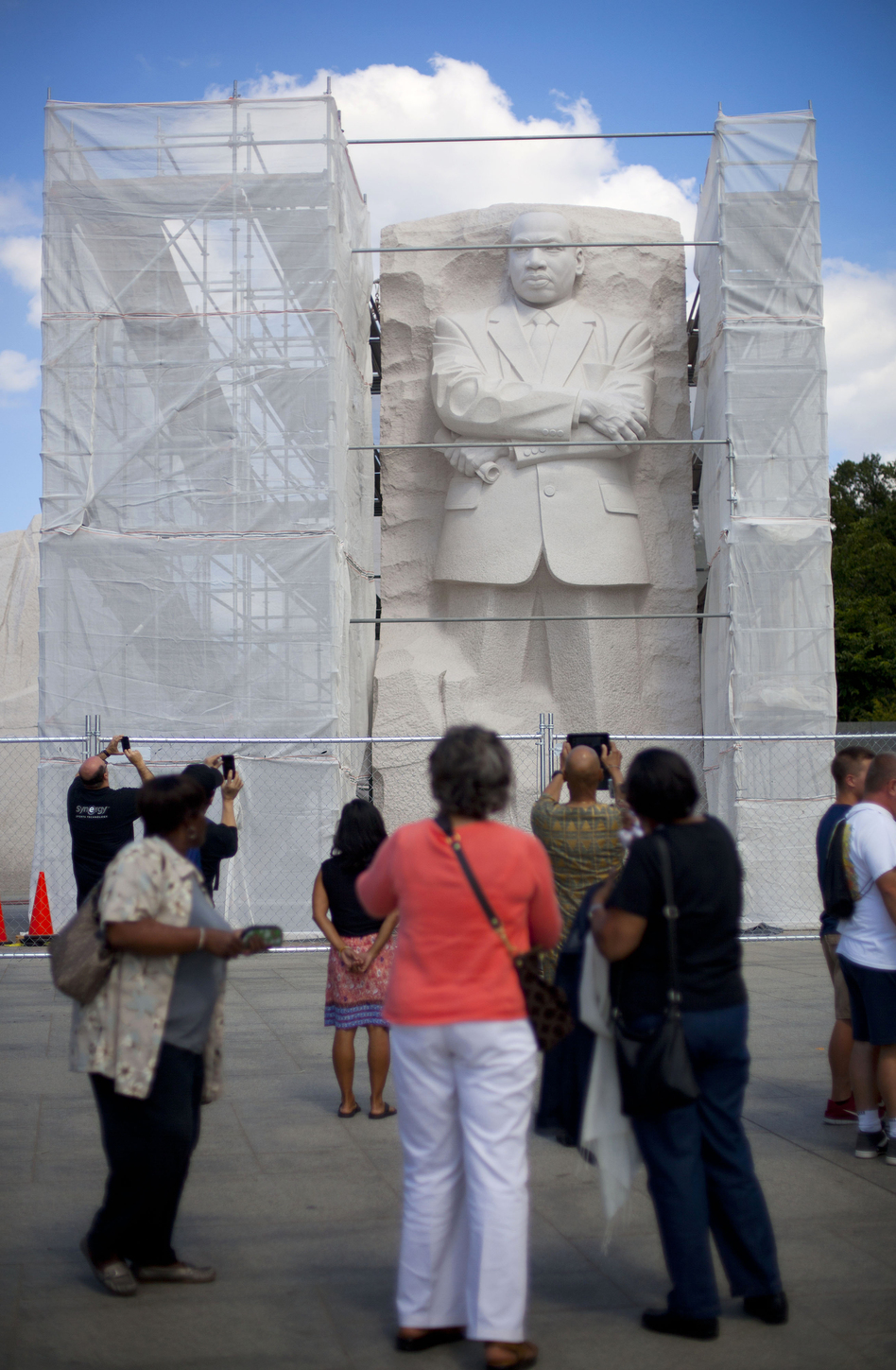 <strong>Under Construction:</strong> A recent survey of Americans found that fewer than half believe the U.S. has made substantial progress toward racial equality. Here, the Martin Luther King Jr. Memorial in Washington, D.C., is boxed in by scaffolding as work is done on it. (Pablo Martinez Monsivais/AP)