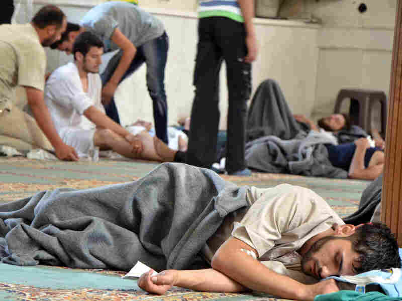 A survivor from what activists say was a chemical weapons attack rests inside a mosque in the Duma neighborhood of Damascus, Syria, on Wednesday.