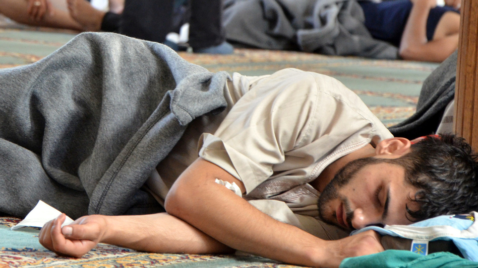 A survivor from what activists say was a chemical weapons attack rests inside a mosque in the Duma neighborhood of Damascus, Syria, on Wednesday. (Reuters/Landov)