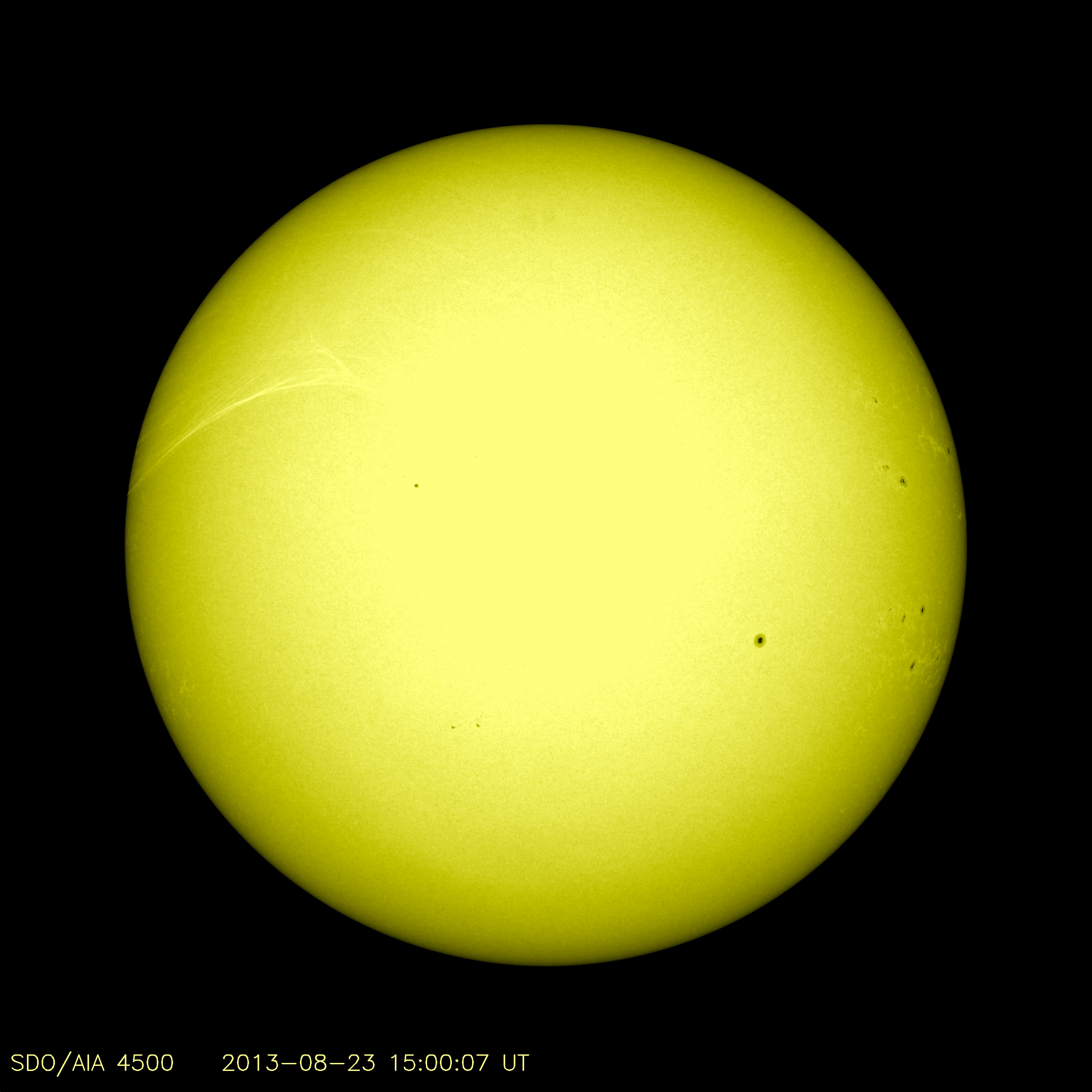 This channel shows the features that our eyes would see if we could dim the sun's intensely bright light. This wavelength of light is visible to people as blue-indigo, although here it is shown in yellow. Sunspots stand out sharply here, and you can also see that the edge of the sun appears darker, a well-known effect called limb darkening.