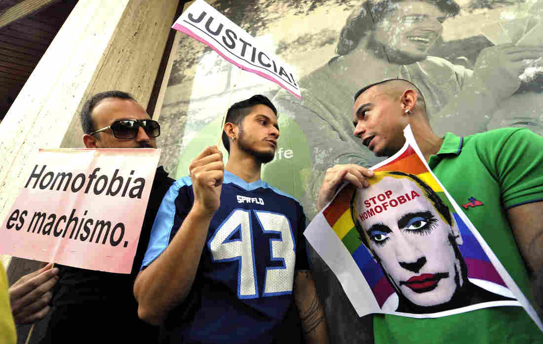Demonstrators protest against homophobia and repression of gays in Russia, in front of the Russian Embassy in Madrid on August 23, 2013.