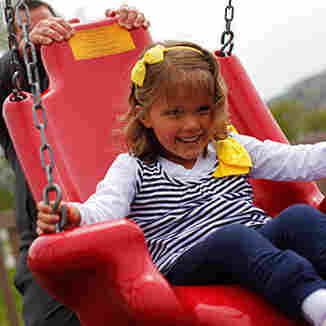 An accessible swing provides extra back and side support to help children with physical disabilities.