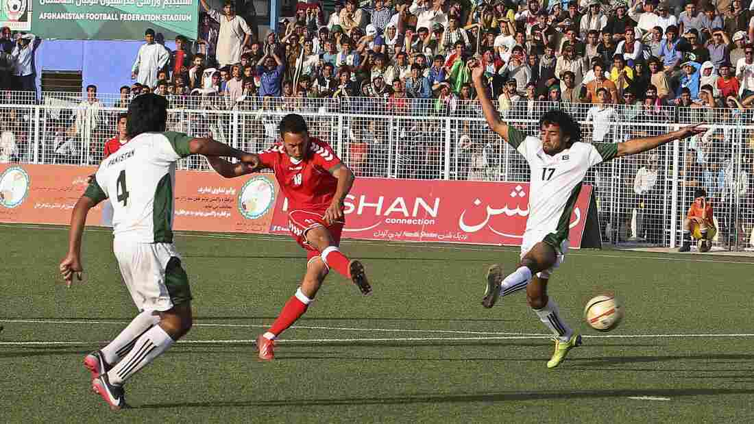 Afghanistan and Pakistan, countries that have a history of tense relations, played their first soccer match in nearly 40 years when they met Aug. 20 in Kabul. Afghanistan (in red) won 3-0.