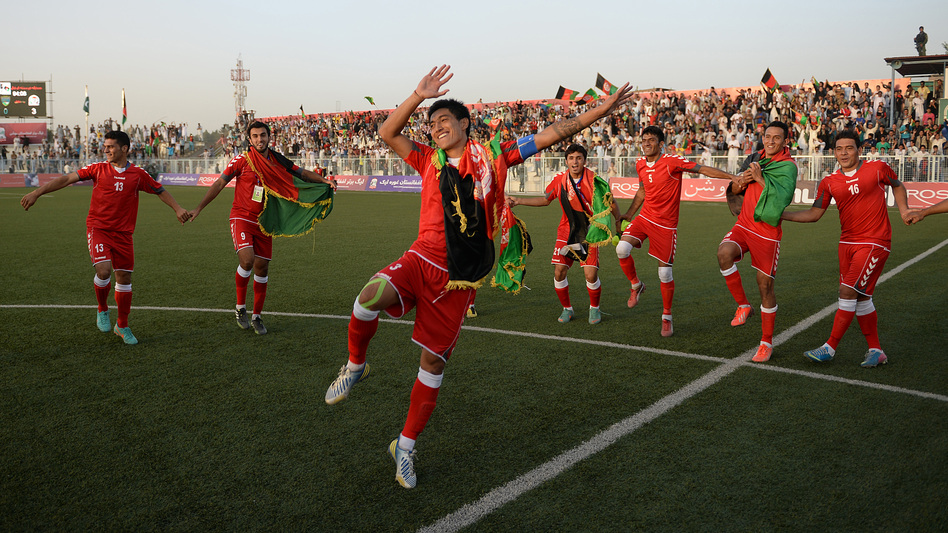 Afghan soccer players celebrate their 3-0 win against Pakistan on Aug. 20 in Kabul. (AFP/Getty Images)