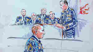 Staff Sgt. Robert Bales, foreground, is seen in a courtroom sketch earlier this week, as prosecutor Lt