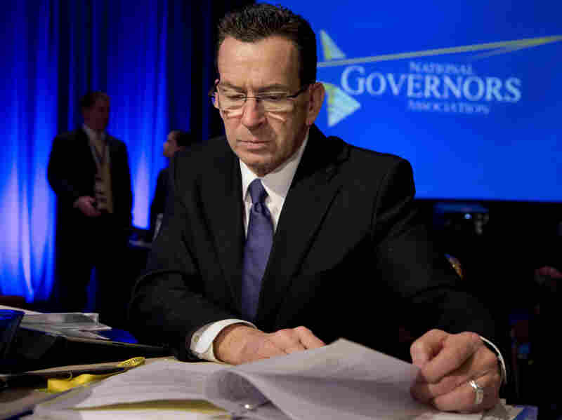 Connecticut Gov. Dan Malloy reads documents during the National Governors Association's winter meeting in Washington on Feb. 23.