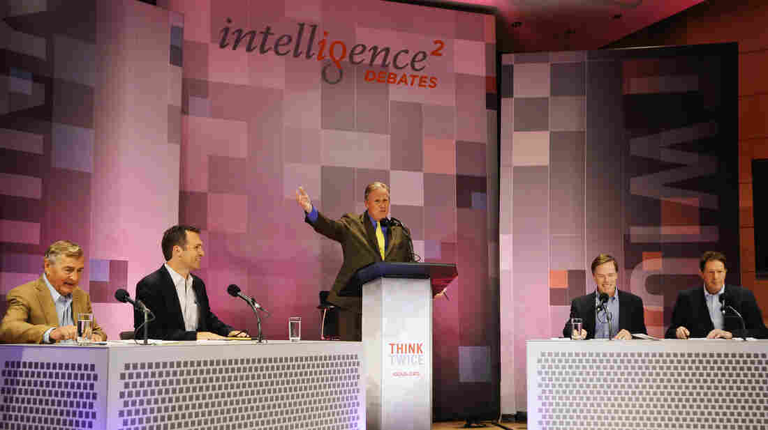 John Donvan moderates an Intelligence Squared U.S. debate on Syria at the Aspen Institute in Aspen, Colo. Those debating are: (from left) Graham Allison, Richard Falkenrath, Nicholas Burns and Nigel Sheinwald.