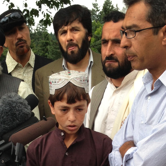 Sadiqullah (center), who was shot by Robert Bales and was a witness in the trial, stands with some of the Afghan civilians who traveled from Kandahar to the U.S. for Bales' trial. He spoke to the media after Bales' life sentence was announced Friday.