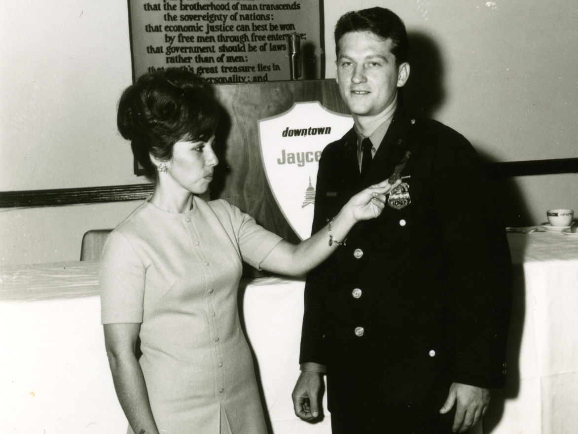 "Martin Niverth with his wife Nancy, when Martin was named ""officer of the month"" in 1964."