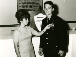 """Martin Niverth with his wife Nancy, when Martin was named """"officer of the month"""" in 1964."""