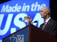 Florida Gov. Rick Scott shows a photo of one of his grandchildren while addressing the Wal-Mart U.S. Manufacturing Summit in Orlando on Thursday.