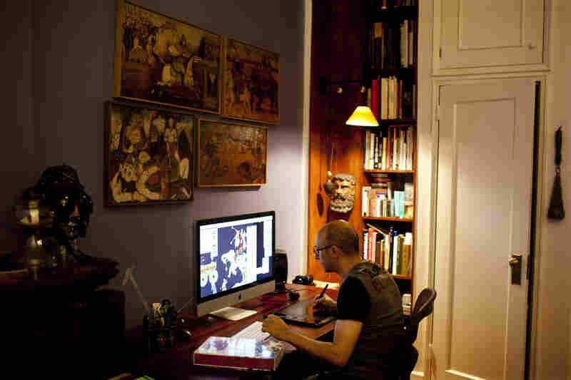 The wall above Rahmanian's desk is adorned with wooden reliefs of stories from the Shahnameh, depicted in a style known as Ghahve Khane. Rahmanian says looking up at the images while he worked would rest his eyes and offered a reprieve from the computer screen.