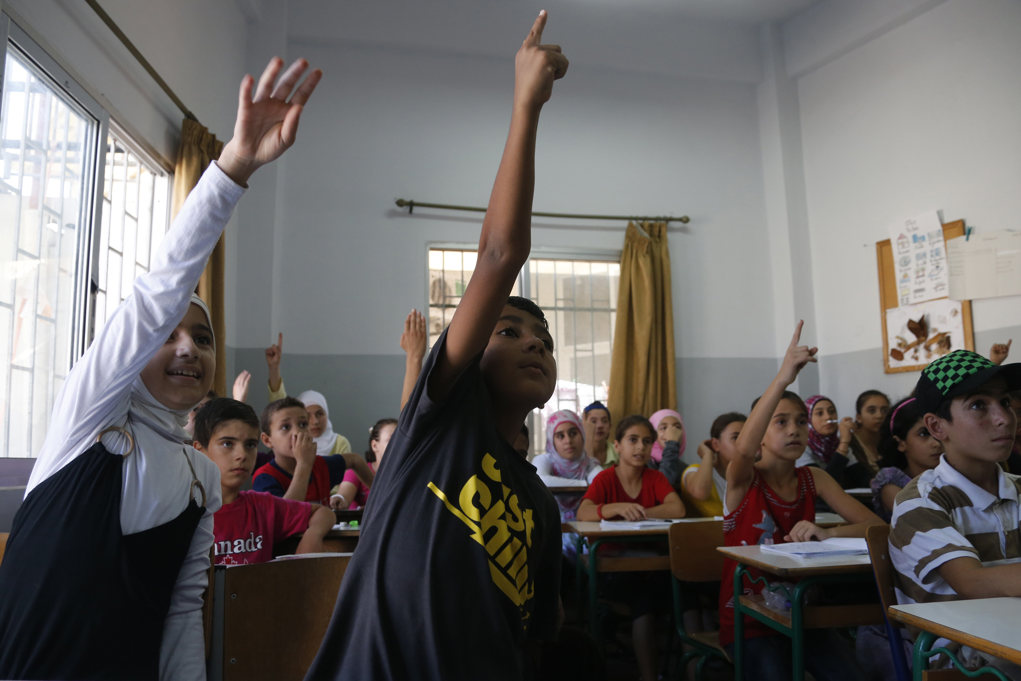 Syrian refugee children attend a class in Chekka, Lebanon on July 29. An estimated one million Syrians, including refugees, laborers and their families, currently live in Lebanon, twice the number that were in the country in April.