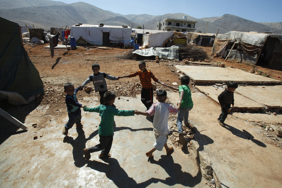 Children play at a refugee camp in Terbol, Lebanon in July 31. At a camp in Terbol, refugees beseech visiting aid workers to improve sanitation and other services at the site. Formerly a settlement for migrant workers on privately owned land, the site's unplanned growth in recent months has strained already limited resources.  (Reuters/Landov)