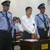 Bo Xilai, in white shirt, on Thursday during his trial on corruption charges at the Jinan Intermediate People's Court in China's Shandong Province.