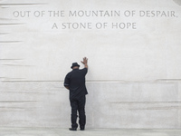 Rev. Bobby Turner or Columbus, Ohio, places his hand on the Martin Luther King Jr. Memorial on Thursday, in Washington, D.C.