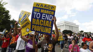Demonstrators on Saturday in Washington, D.C., commemorate the 50th anniversary of the March on Washington for Jobs and Freedom.