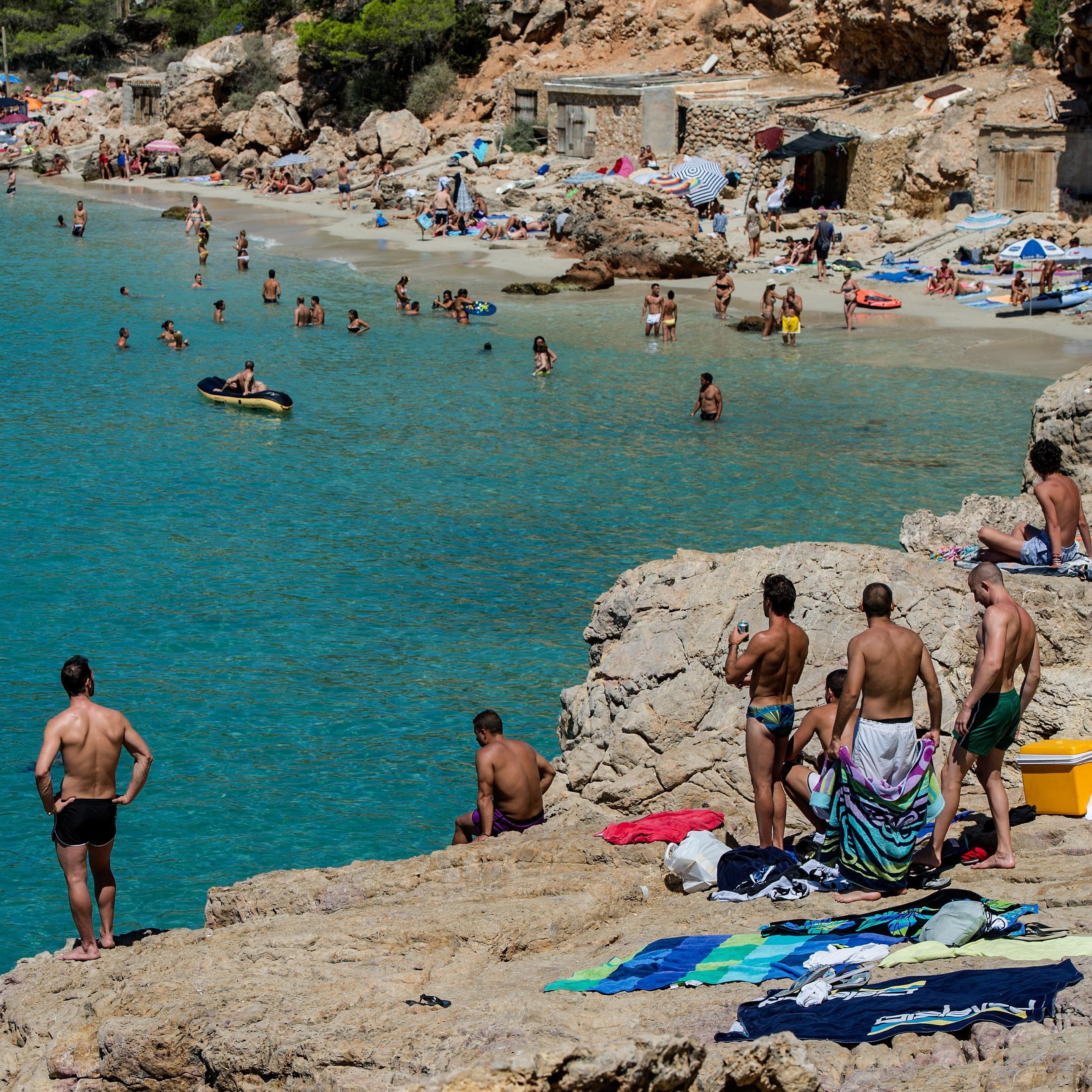 Island Beach People: Beachgoers In Spain Face Invasion Of Jellyfish