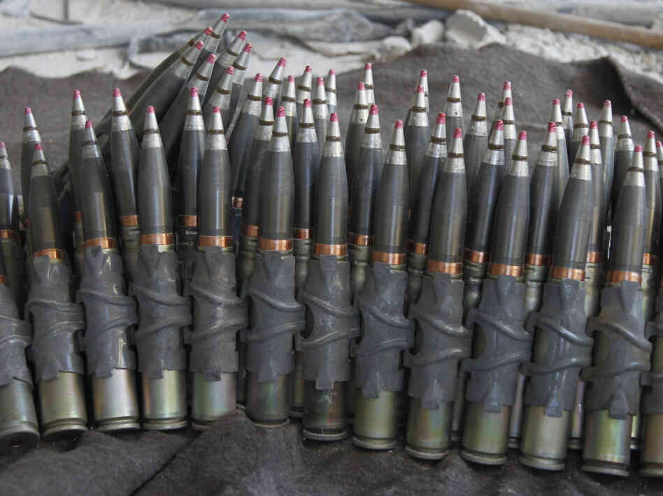 Ammunition was stacked up Saturday in an area near Damascus that is controlled by forces loyal to President Bashar Assad.
