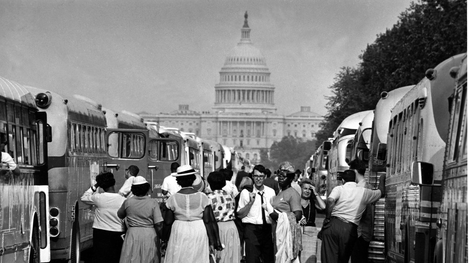 Charter bus passengers look for their transportation home after the March on Washington of Aug. 28, 1963. (AP)