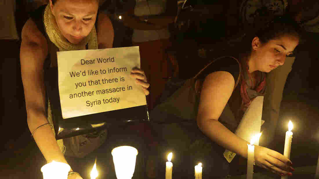 Syrian women light candles Aug. 21 in front of the U.N. headquarters in Beirut during a vigil against the alleged chemical weapons attack on the suburbs of Damascus, Syria. The U.S. and its allies are considering their next steps against the governme
