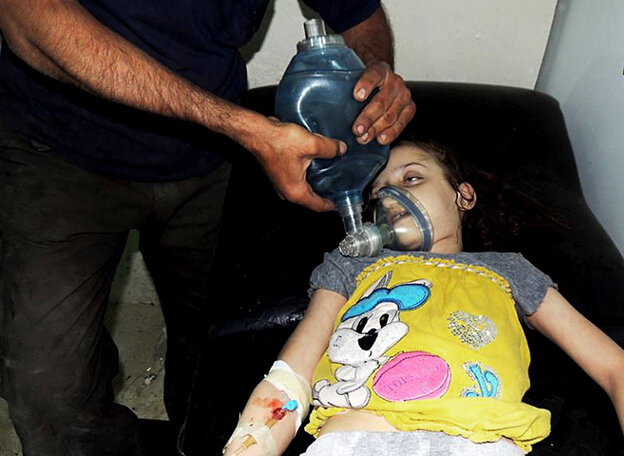 A young girl receives treatment at a makeshift hospital in Damascus, Syria, after a suspected chemical weapons attack by the military.