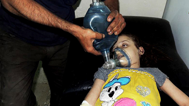 A young girl receives treatment at a makeshift hospital in Damascus, Syria, after a suspected chemical weapons attack by the military. (AP)