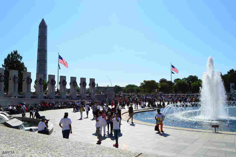 Crowds gather at the World War II Memorial.