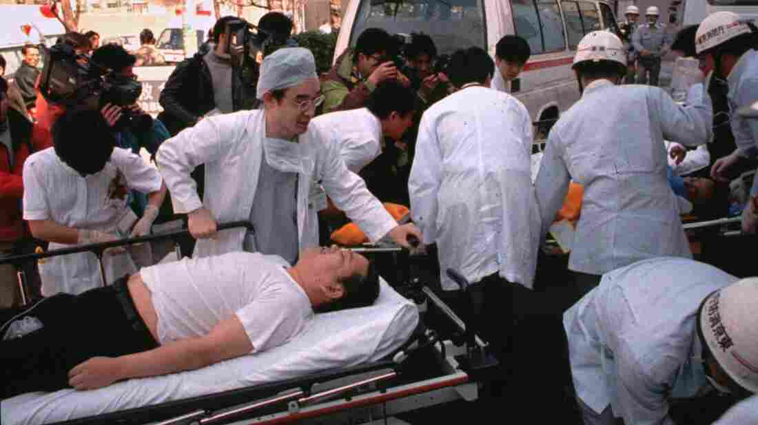 Subway passengers affected by the sarin gas attack on Tokyo's subway system are carried into St. Luke's International Hospital in Tokyo on March 20, 1995. Thirteen people were killed and more than 6,000 injured in the attack, which was carried out by the Aum Shinrikyo cult.