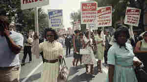 Demonstrators march through the streets. Colorized by Oliver Wistisen.