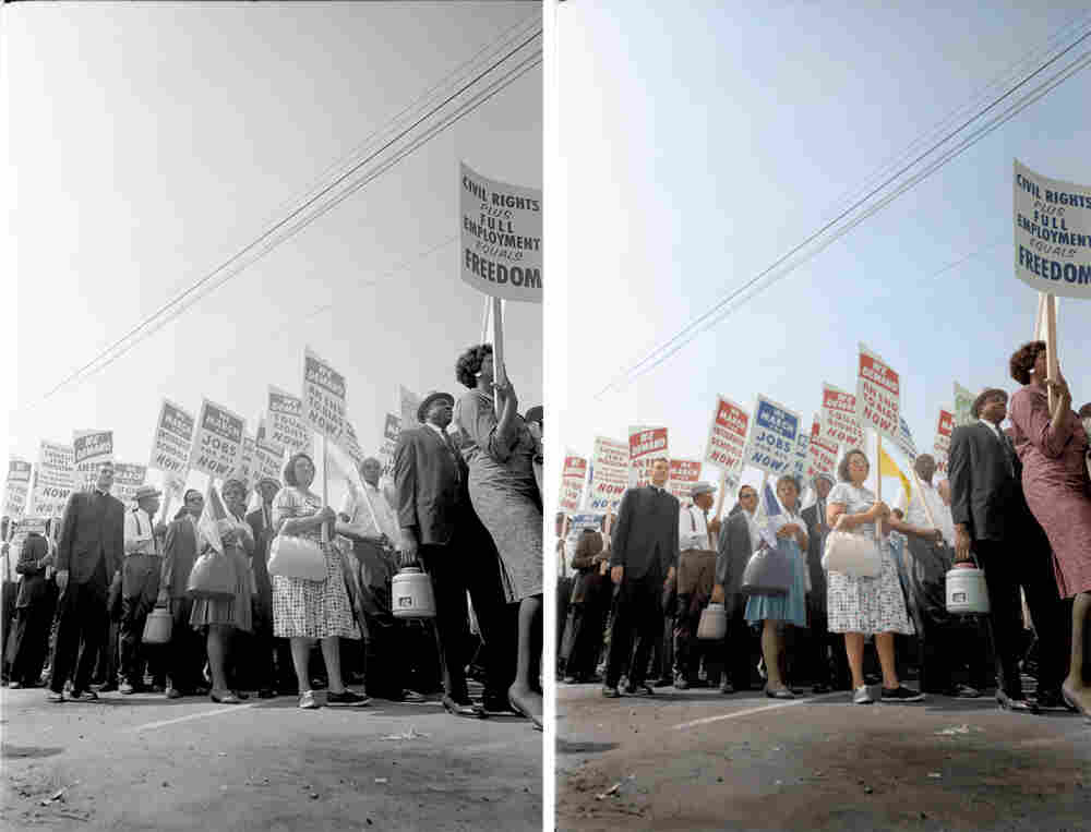 Demonstrators march through the streets. Colorized by Paul Edwards.