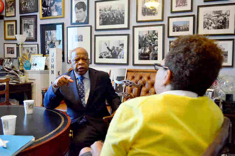 Host Michel Martin interviews Rep. John Lewis in his Washington D.C. office. Historical photos and memorabilia line the walls.