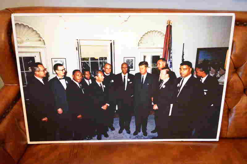Rep. Lewis stands near Martin Luther King Jr. during a gathering with President John F. Kennedy and other civil rights leaders.