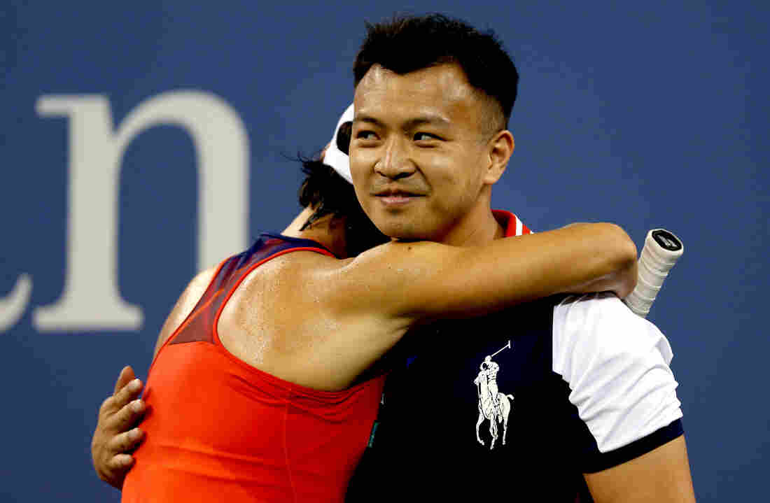 Francesca Schiavone of Italy hugs a ball boy during her first-round women's singles loss to Serena Williams at the 2013 U.S. Open Monday night.