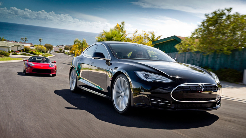 Tesla Motors has outsold several luxury carmakers in California in 2013, on the strength of its Model S, seen here in the foreground. The Telsa Roadster is behind it. (Telsa)