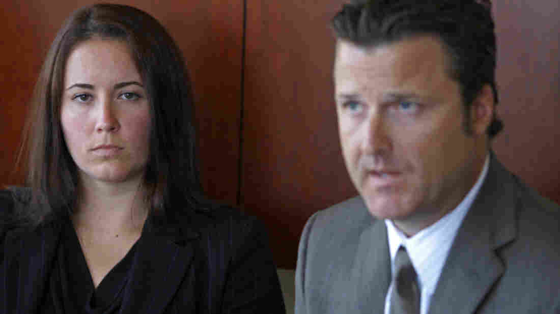 Attorney Robert Allard, seen here with former swimmer Jancy Thompson in 2010, says USA Swimming still needs to improve its handling of sexual abuse claims. The organization is also facing congressional scrutiny.