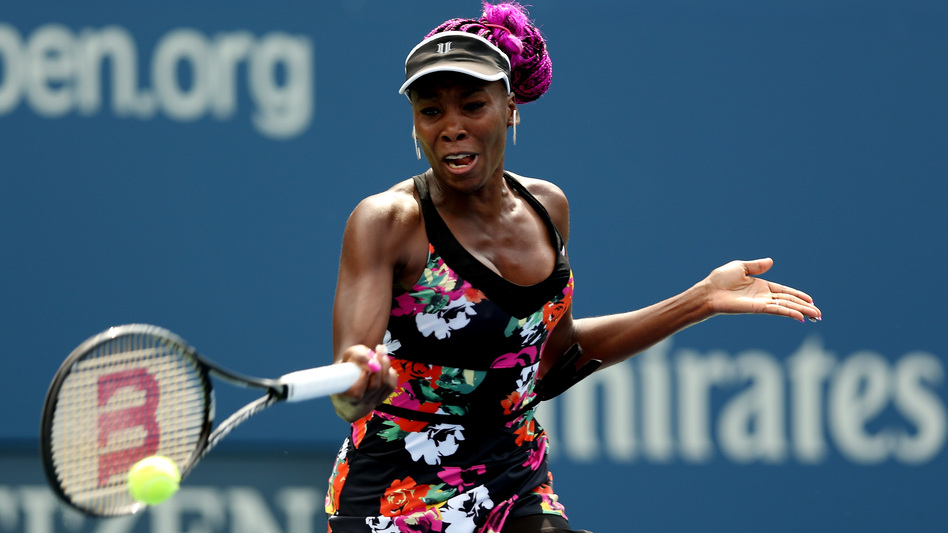 Venus Williams hits a forehand during her first-round win over Kirsten Flipkens of Belgium Monday.