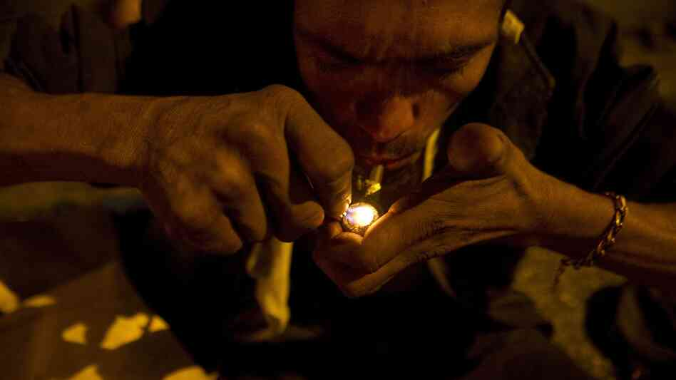 A homeless man smokes crack in the Barrio Triste neighborhood in Medellin, Colombia.