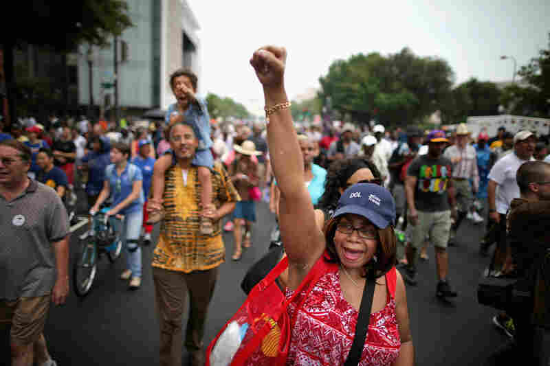 Thousands of people, including Joyce Elliotte, march from Capitol Hill to the Lincoln Memorial to commemorate the historic march for jobs and freedom.