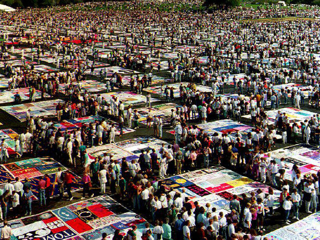 "The AIDS Memorial Quilt on display at the Washington Monument in October 1992. The AIDS crisis is the subject of John Corigliano's Symphony No. 1, ""Of Rage And Remembrance."""