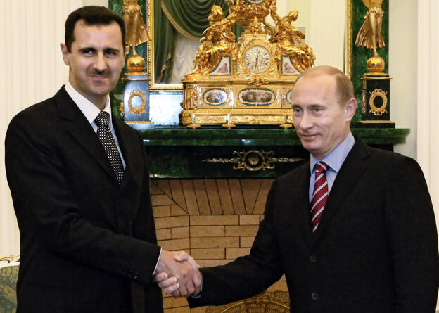 """Russian President Vladimir Putin greets his Syrian counterpart, Bashar Assad, in Moscow on Dec. 19, 2006. Russia --€"""" along with China and Iran --€"""" has remained a steadfast ally of Assad amid calls for international intervention in Syria."""