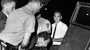 A white heckler arrested during an anti-segregation demonstration in Lexington, Ky., is hustled into a police car in August 1963. Forty years later, the Lexington Herald-Leader ran a correction apologizing for the newspaper's lack of coverage of the civil rights movement.
