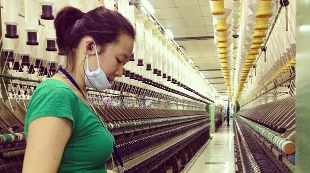Jess Jiang in cotton yarn factory