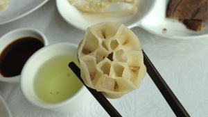 The Lotus Dumpling: Stuffed with pork and lotus root, this dumpling has 13 holes on the top, just like the lotus seedpod.