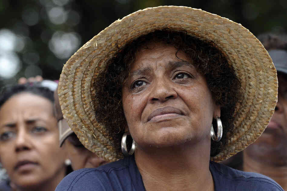 Sandy Redman of Pine Top, N.C., cries as she listens to Obama speak. Redman attended the first march 50 years ago.