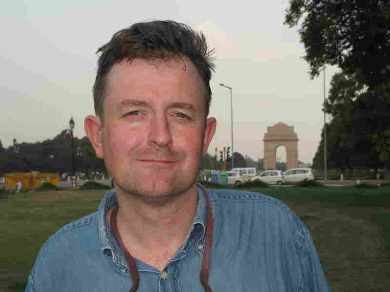 Tarquin Hall, shown here near the Rajpath in Delhi, is a British-born journalist and author. The Case of the Missing Servant, the first book in the Vish Puri series, was his first mystery novel.