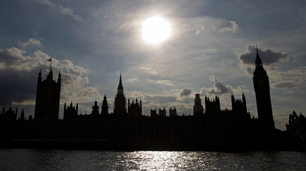 The Houses of Parliament are silhouetted against a setting sun as lawmakers debate possible British military action in Syria. (AFP/Getty Images)